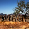 An old fence in the arid Arizona noonday sun