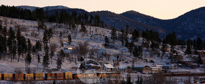 Freight train moving through Flagstaff at sunrise. It had snowed a bit the night before.