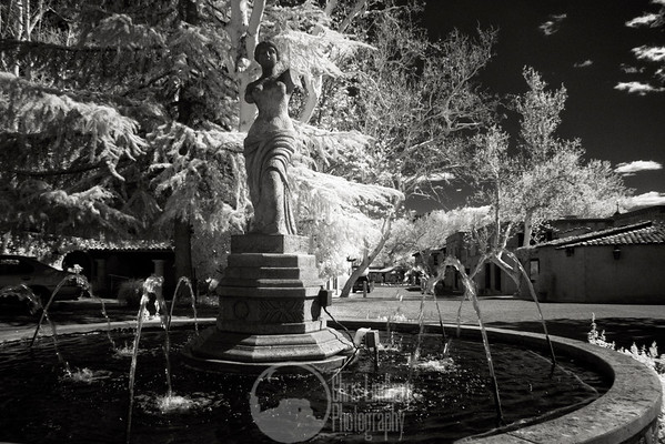 Tlaquepaque Lady  Infrared of the fountain at the front of Tlaquepaque in Sedona.  Looks nice and old world but for the couple of cars in frame.