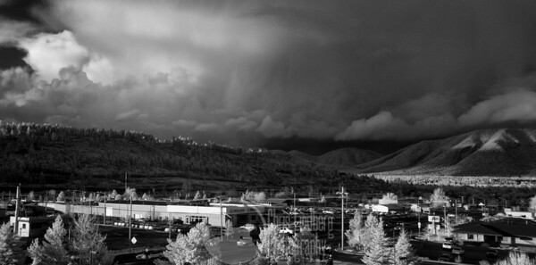 Sunset over Flagstaff. The storm front moving away was quickly followed by a second...  This one is a composite panorama.