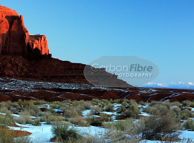 First Sun on Spearhead Mesa and Blue Mountains, Monument Valley
