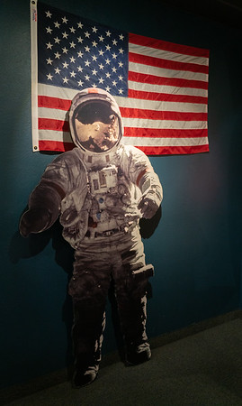 Astronaut with American Flag at Meteor Crater