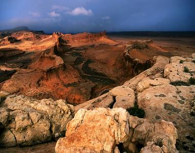 Sunrise storm light over Chinle Wash - Navajo Reservation