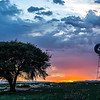 Old fashioned windmills are disappearing from the American landscape. This beautiful windmill is on a historic, working ranch in the Williamson Valley area, just north of Prescott, AZ. The setting sun illuminated a thunderstorm cell on the horizon, creating a range of pastel colors in the sky.