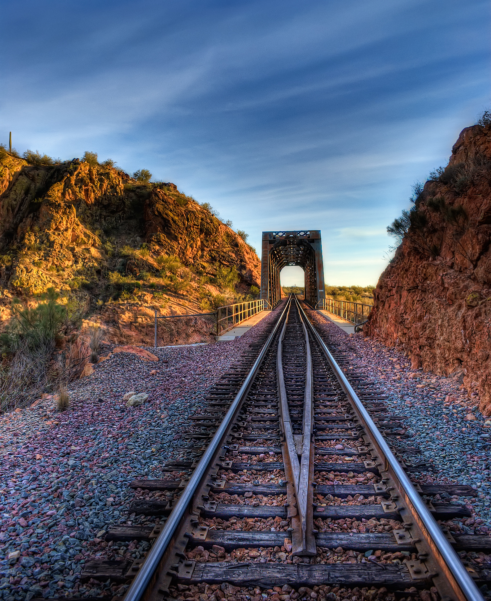 Sunset at a rail road bridge along the Hassayampa River