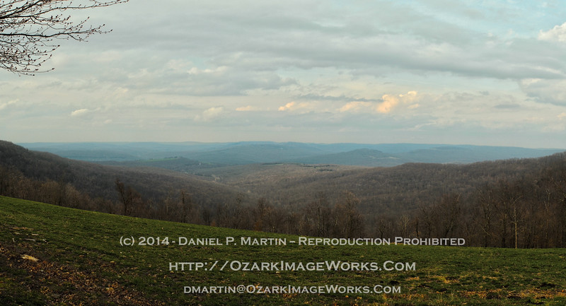 "Early springtime sunset - Cannon Creek Valley from Brannon Mountain Road. <br /> <br /> ""As the crow flies,"" this view is almost exactly due west of Crosses, AR.  The small white pip about a third of the way across from the left-hand side of the image is the Mount Olive Water District tower near AR Highway 16, approximately 1 mile east of the Madison / Washington County line.<br /> <br /> Digital composite panorama, reconstructed from 10 individual images."