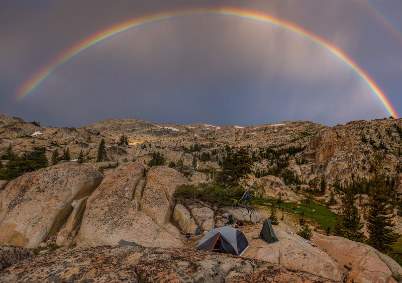 Morning showers bring a big and bright double rainbow to our campsite
