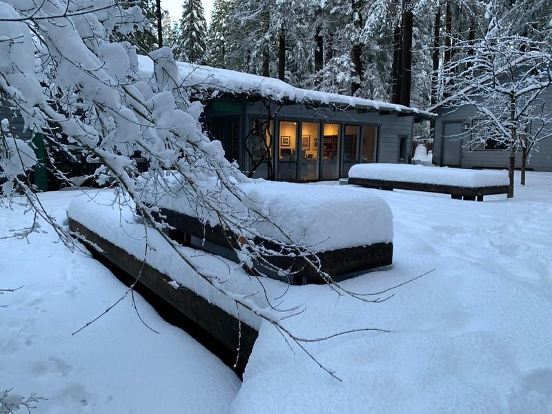 Snow on the backyard deck