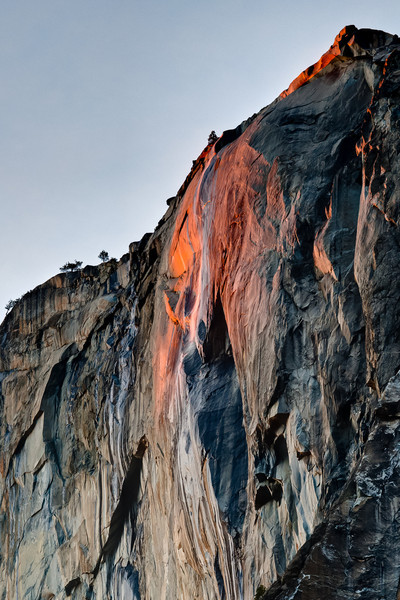 Sunset focuses on Horsetail Falls, east wall of El Capitan, Yosemite National Park