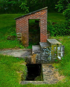 Old abandoned spring house, once attached to the house that sat here and burnt down years ago.  The Water Authority for our township bought the property to tap the spring, but has never used it.
