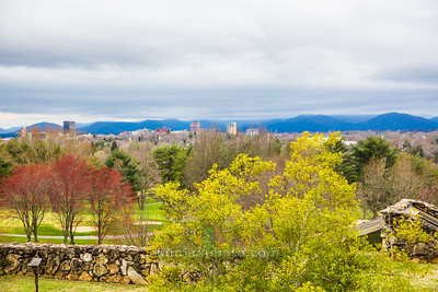 Countryside overlooking downtown Asheville, NC with the Blue Ridge Mountains in the background.