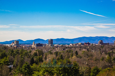 Downtown Asheville, NC with the Blue Ridge Mountains in the background.