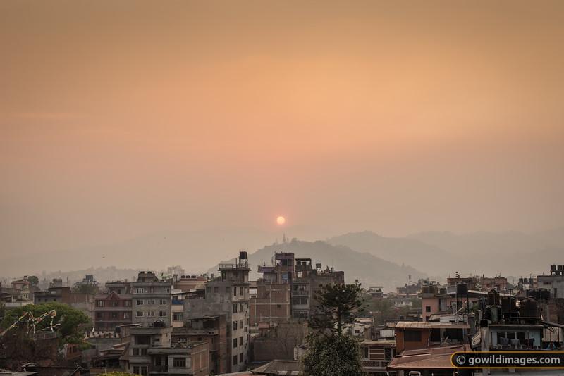 Sunset over Swayambunath temple through the Spring haze