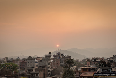 Sunset over Swayambunath temple through the Spring haze