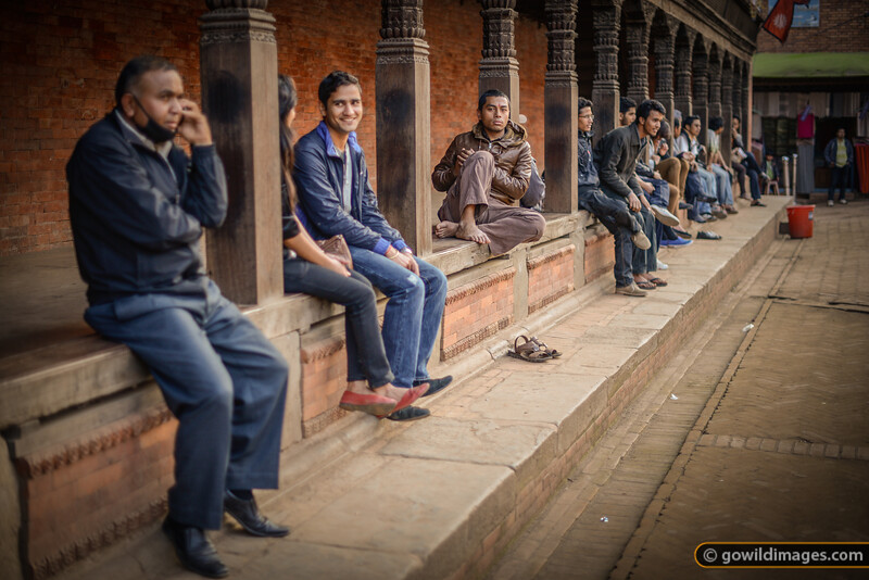 Locals relaxing on the edge of Durbar Marg