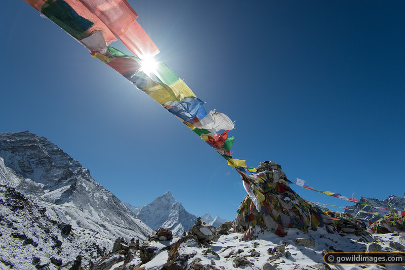 Prayer flags adorn a pass on the way to Lobuje.