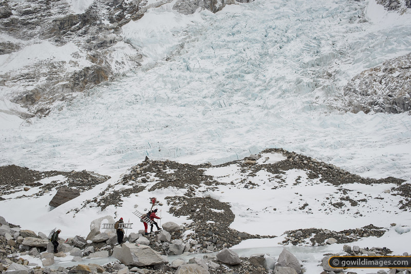 Icefall Doctors head out, with the fearsome jumble of the icefall beyond.  [Update: 7 April 2013. RIP Mingmar Sherpa who lost his life after falling into a crevasse near the top of the icefall. My thoughts are with his wife, Mrs Fur Diki Sherpa, children and friends. A collection at Base Camp raised around $3000 for his family and his employer, the SPCC, contributed a further NR150,000.]