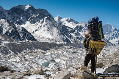 Porter takes a breather as he heads to base camp