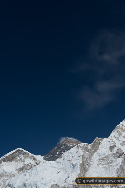 Mt Everest (centre) with it's west ridge (L) and part of Nuptse (R)