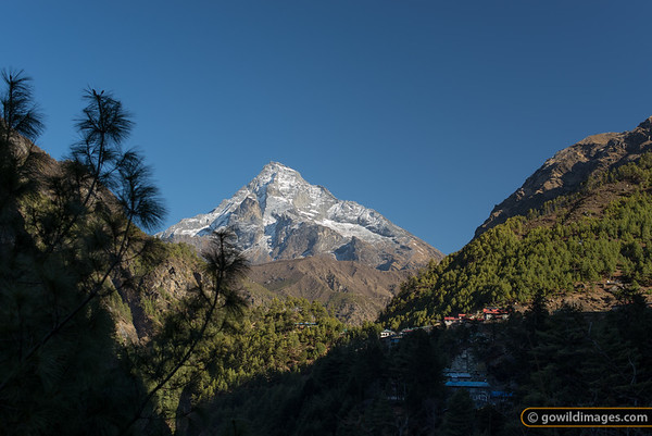 Monjo village and Khumbila (5761m). This is a sacred peak and has not been climbed.