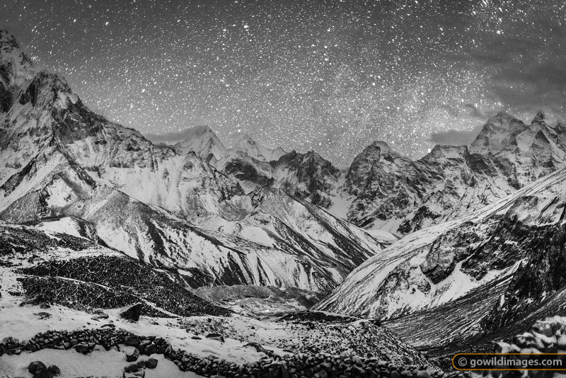 Night view from Dughla towards Pheriche (light visible) with Ama Dablam framing left and Kangtega, right.