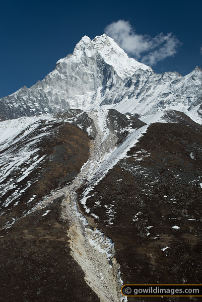 Kangtega peak. The name means 'horse saddle' which mirrors the shape of the two peaks and high pass between them.