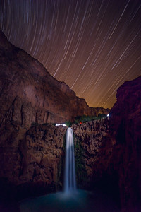 Stars dancing above magnificent falls