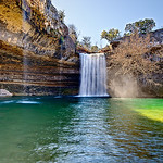 Hamilton Pool and Waterfall in the Afternoon. Outside of Austin Texas is a natural feed pool that looks like you are in Hawaii. This is one of my favorite places to go near Austin. It takes about an hour to get there, but after a short stroll, you are in this magical place!