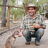 Andy Suarez feeding a Mareeba rock-wallaby (Petrogale mareeba) at Granite Gorge Nature Park