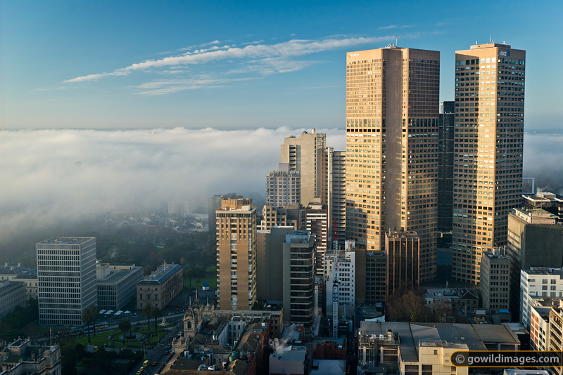 Morning fog lifts as Melbourne begins to warm up, on a mid-winter's day