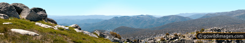 View from Mt Cobbler summit with people on the false summit. The Razor and The Viking are behind.