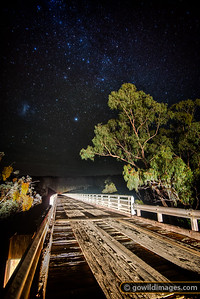 The Greater Magelannic Cloud is the only cloud in the sky on a cold Winter night at McKillops Bridge, Snowy River NP. With a 255m span – the longest metal-truss, wooden bridge in the state, first built in 1931 and rebuilt in 1936 after a flood