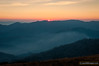 Sunrise over Mt Buggery, Crosscut Saw and Mt Howitt from Mt Stirling. The planet Mercury is visible over the Crosscut Saw (in a larger version of this image). Smoke from a nearby bushfire fills the valleys below around 1000m