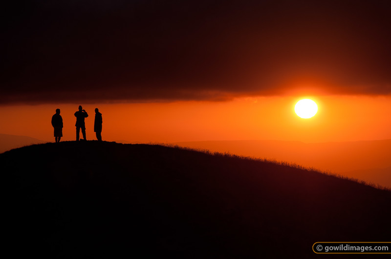 Hikers on the summit of Mt Feathertop at sunset