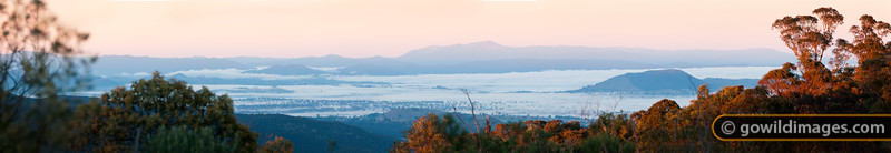 From Mt Samaria, looking South over Mansfield and 'The Paps' (680m) on the right. Further back, Lake Eildon hides under early morning fog, with Mt Torbreck (1500m) looming behind. This panorama can be printed up to 1.3m wide at full photo-quality