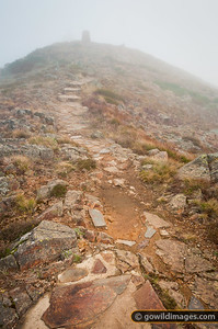 Cairn visible through the fog on the way up to Mt Buller summit on a foggy afternoon