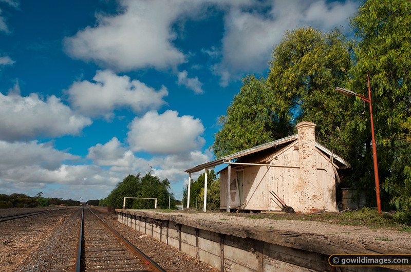 McCarthur road railway station/station master's cottage, between Ouyen and Mildura. The building is long-disused, but the rail line is still active. Other angles available.