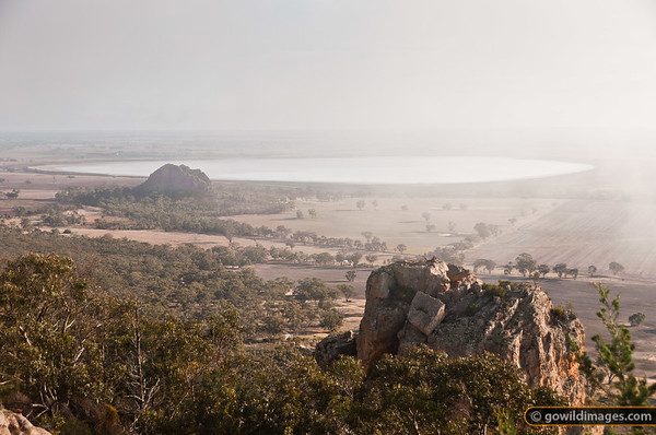 Mitre Lake and Mitre Rock in the distance, with 'Araps' boulders close by. Taken from near the summit of Mt Arapiles.