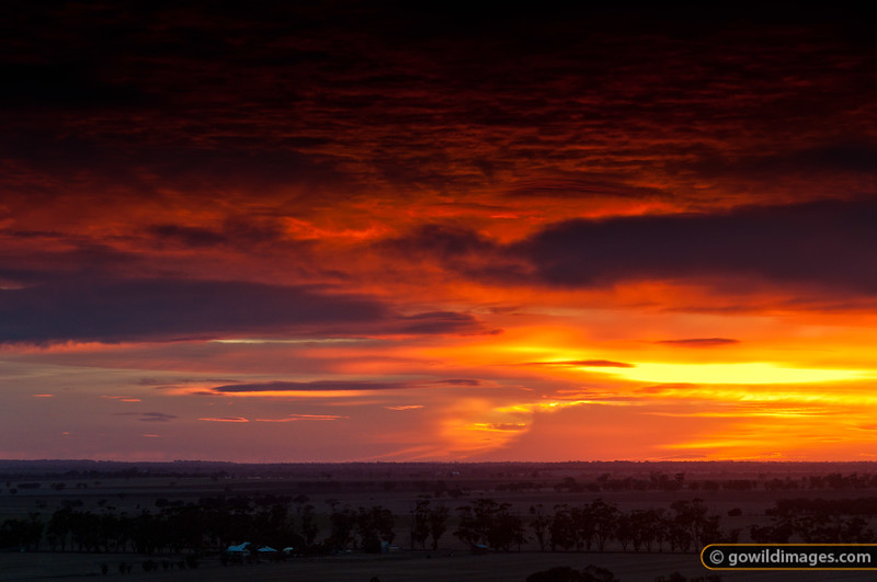 A late Autumn sunrise from Mt Arapiles. Another version is available.