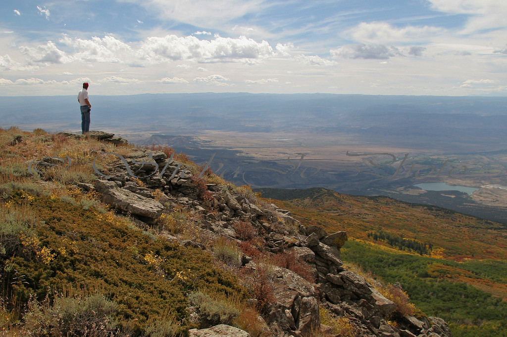 I can see for miles...<br /> Taken from top of Grand Mesa, just before the Lands End Visitor Center. Elevation 11,000 feet, view to the Grand Valley, 6,000 below.