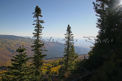 I love this view, it is almost at the summit of the Grand Mesa. Every year I stop and shoot the subtle changes. When I saw how bad the smog, mostly from western fires, was this year (fall 2006) I almost did not stop, I didn't want to shoot the polluted haze. Then I realized I had to, it needs to be shown...whether to remember how it was, or to remind us how it can be again. You should be able to clearly see mountains ranges that are hundreds of miles from here...this day, even the closer mountains were obscured. Beauty, ugly, and the ugly hiding all the beauty... sad.