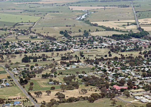 """Boorowa Town with """"The Top Dam"""" on the Boorowa River near centre in the upper part of the frame."""