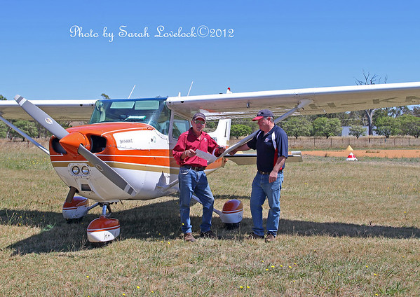 Richard and pilot Brad Pearsall at Young Airport discuss the flight plan for the days shoot.