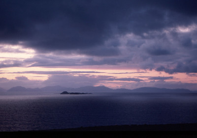 Storm clearing at sunset over the Outer Isles, from North Skye