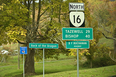 The Back of the Dragon sign in Marion, Virginia. The Back of the Dragon runs 32 miles between Marion, Virginia and Tazewell. The challenging mountain road has reverse curves, switchbacks, and steep mountain grades.