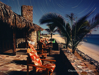 Moonlit Casa Piedra under star trails in the night sky of Baja California Sur, Mexico