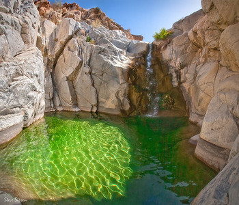 Baja California Emerald Pool Mineral water from a mountain spring near Guadalupe Peak pours in the emerald pool cold spring in this secluded desert Canyon.
