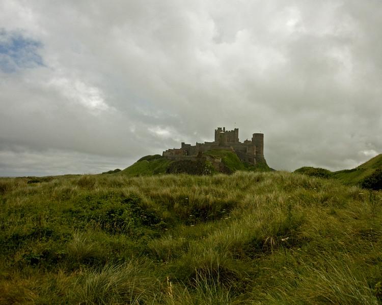 Bamburgh castle under cloud