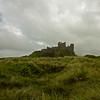 Bamburgh castle under cloud