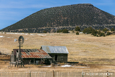 Nice New Mexico barn with the Capulin Volcano National Monument in the background.  A seven frame HDR composite.